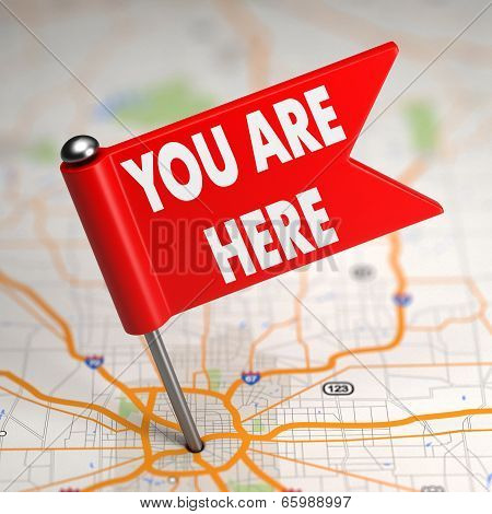 You Are Here - Small Flag on a Map Background