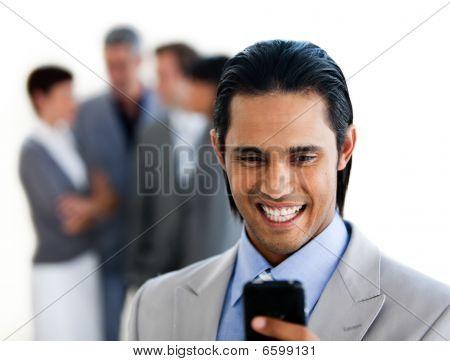 Focus On An Ethnic Businessman Sending A Text