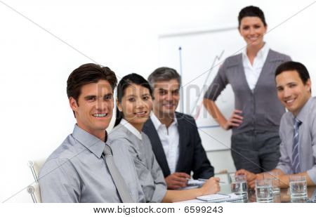 Smiling International Business People At A Presentation