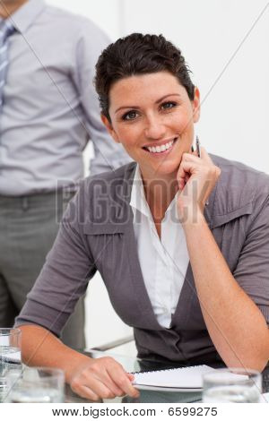 Smiling Confident Businesswoman Taking Notes