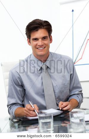 Male Executive Consulting His Agenda In A Meeting