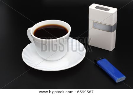 Cup Os Coffee. Cigarettes And Lighter.
