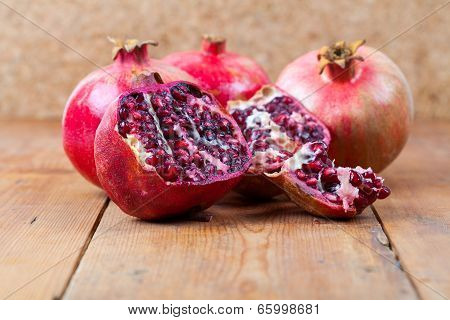 Fresh Pomegranate Fruit On Wooden Surface