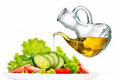 picture of vegetarian meal  - Healthy Vegetable Salad with Olive oil dressing isolated on white background - JPG