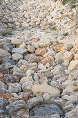 stock photo of ravines  - Full frame take of boulders in the bed of a ravine - JPG