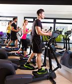 picture of elliptical  - Aerobics elliptical walker trainer group at fitness gym workout - JPG