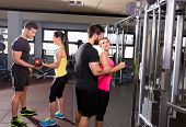 image of pulley  - cable pulley system gym and dumbbell fitness people group with personal trainer - JPG