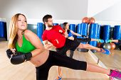 stock photo of sparring  - Boxing aerobox group low kick training at fitness gym mirror - JPG