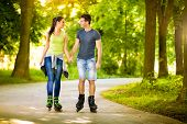 foto of skate  - Young love couple spending free time  together - JPG
