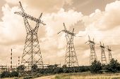 foto of power transmission lines  - Pylon and transmission power line in sunset - JPG