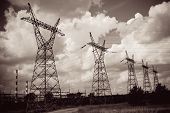 stock photo of power transmission lines  - Pylon and transmission power line in sunset - JPG
