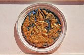 picture of surya  - statue of Surya in a thai architectural