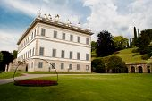 stock photo of neoclassical  - neoclassical villa with beautiful garden on the shore of Lake Como - JPG