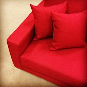 stock photo of futon  - Comfortable bright red sofa with two cushions - JPG