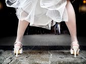 pic of stocking-foot  - feet of bride dress with heels and flight - JPG