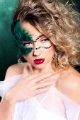 stock photo of carnal  - young beautiful girl in a carnival night - JPG