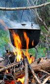 stock photo of cauldron  - Cooking in the nature - JPG