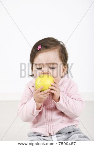 Baby Enjoying An Apple