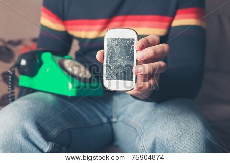 Man With Broken Smart Phone And Rotary Telephone