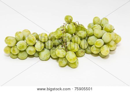 Bunch Of Green Seedless Grapes On A White Background
