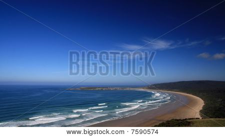 Deserted beach with breakers
