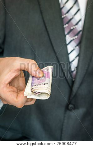 Businessman Giving A Bribe