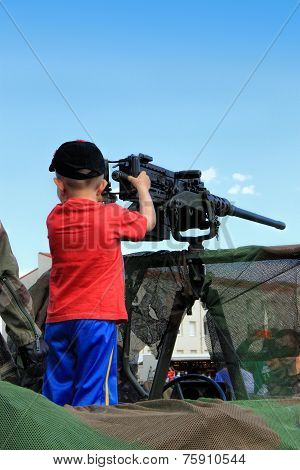 Little Boy With Machine Gun