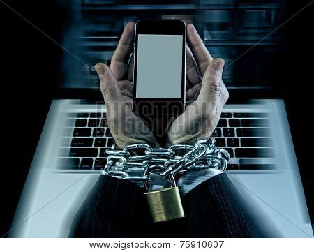 Hands Of Businessman Addicted To Work Locked And Enchained In Mobile Phone Addiction