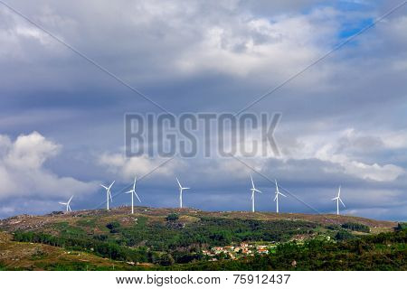 Wind turbine generators on top a hill for the production of clean and renewable energy near Fafe, Portugal