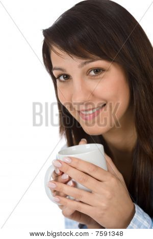Happy Young Woman With Coffee In Pajamas