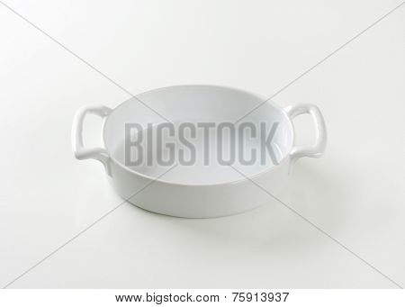 empty casserole dish on white background