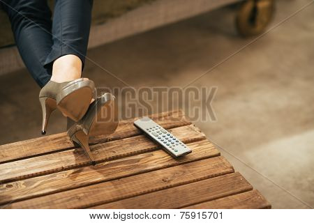 Closeup On Woman Watching Tv In Loft Apartment