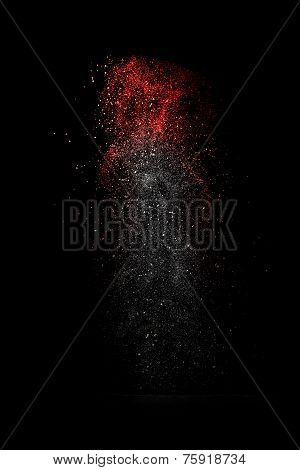 Stop Motion Of White And Red Dust Explosion Isolated On Black Background