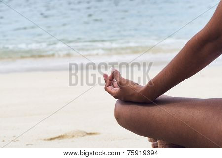 Close up Hand Gesture Indian Woman Performing Yoga at the Beachfront on a Sunny Day.