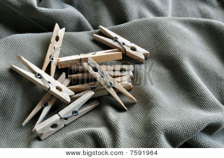 Wooden clothespins on garment