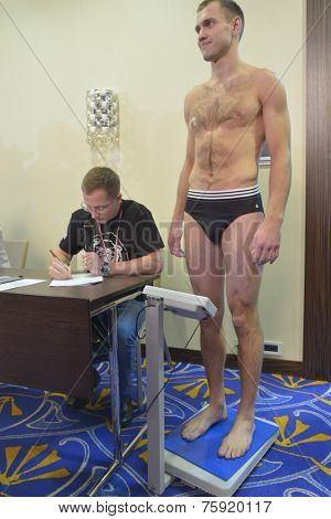 NOVOSIBIRSK, RUSSIA - NOVEMBER 7, 2014: Unidentified athlete during weigh-in before the Friendship Cup. The competitions in 10 kinds of martial arts will start on November 8