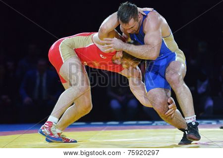 NOVOSIBIRSK, RUSSIA - NOVEMBER 8, 2014: Greco-Roman wrestling match Aslan Abdullin (blue singlet) vs Valery Gusarov during the Friendship Cup. The competitions include 10 kind of martial arts