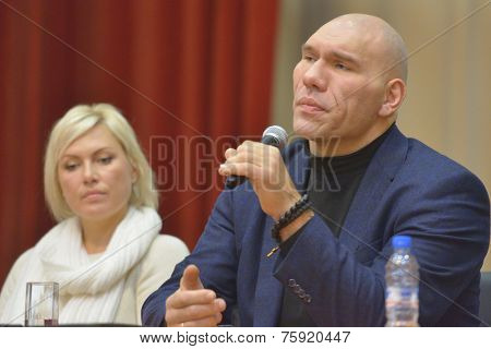 NOVOSIBIRSK, RUSSIA - NOVEMBER 8, 2014: World champions in boxing Nikolay Valuyev and Natalia Ragozina talk with children. The meeting dedicated to the Friendship Cup and aimed to promote the sport