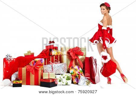 beautiful sexy girl wearing santa claus clothes with christmas gifts