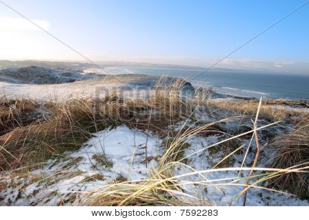 Icy Cold Snow Covered Links Golf Course And Sea