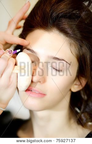 Beautiful Fashion Female Model Getting Makeup