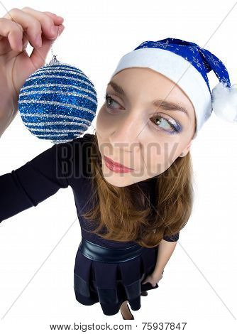 Young woman looking at the christmas ball