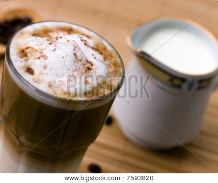 Latte Macchiato with frothy milk, close up