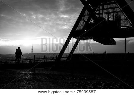 Lovers Standing At The Prague Metronome, Black And White