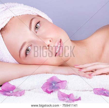 Closeup portrait of attractive gentle female enjoying day spa in luxury beauty salon, alternative medicine, harmony and inner peace concept