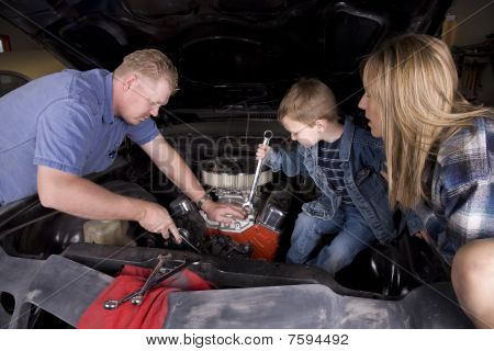 Family Working On Car