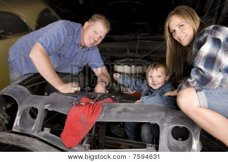 Happy Family Working On Car