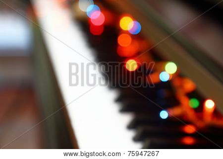 Abstract Christmas musical background with piano and lights.