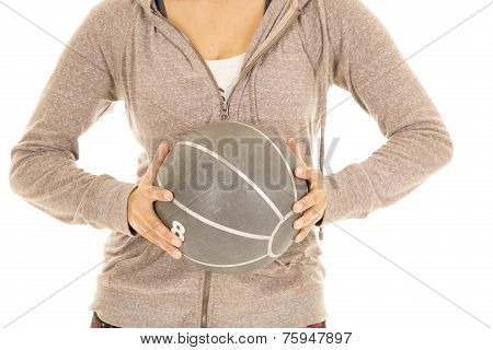 Woman In Jacket Body Medicine Ball In Hands