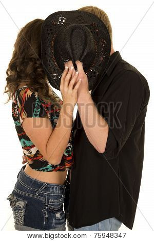 Man Black Shirt Woman Both Behind Hat Kiss